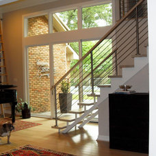 Contemporary Staircase by David Soskolne Projects, Inc