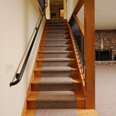 Traditional Staircase by DeHaan Remodeling Specialists, Inc.