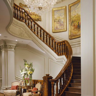Inspiration for a mediterranean wood curved wood railing staircase in Los Angeles with wood risers.