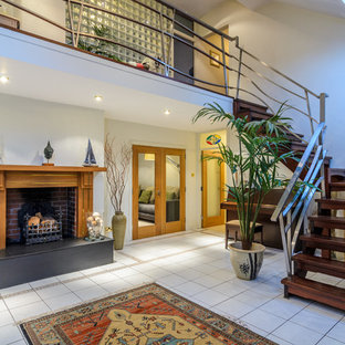 Staircase - eclectic wooden l-shaped open staircase idea in Belfast