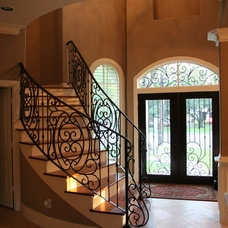 Mediterranean Staircase by Savannah Construction