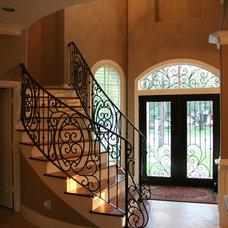 Mediterranean Staircase by Savannah Construction