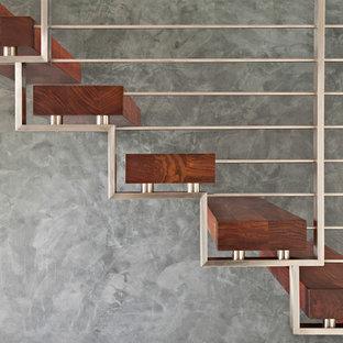 Idee per una scala contemporanea con pedata in legno e nessuna alzata