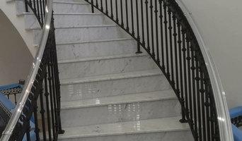 Bespoke Carrara Marble staircase with black rails.