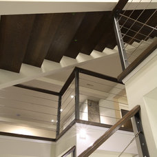 Contemporary Staircase by Best Builders ltd