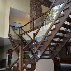 Traditional Staircase by Custom CADD Inc