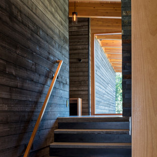 Inspiration for a mid-sized rustic wooden straight staircase remodel in Seattle with metal risers