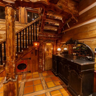 Inspiration for a mid-sized craftsman painted l-shaped wood railing staircase remodel in Vancouver with tile risers