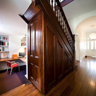 Mid-sized elegant wooden u-shaped wood railing staircase photo in Sydney with wooden risers