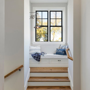 Staircase - coastal wooden wood railing staircase idea in Minneapolis with painted risers