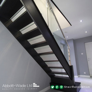 Example of a painted staircase design in Cheshire with glass risers