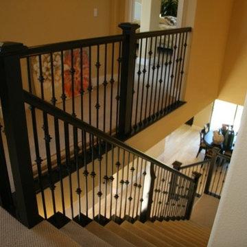 Black painted stair with metal balustrade