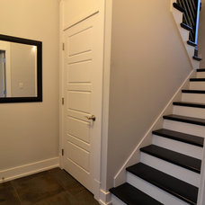 Modern Staircase by Craftsman Construction