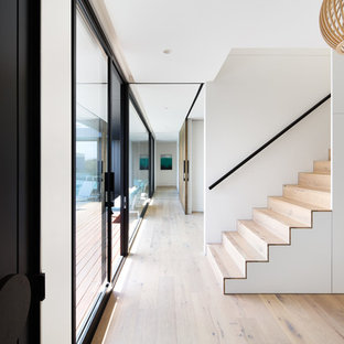This is an example of a contemporary wood straight staircase in Melbourne with wood risers.