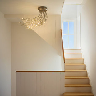 Inspiration for a modern wooden staircase remodel in Providence