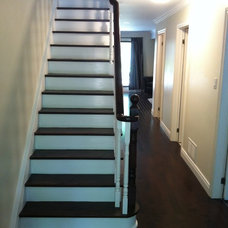 Traditional Staircase by Invision Hardwood & Decor Inc.