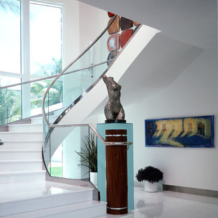 This is an example of a large contemporary curved staircase in Miami.