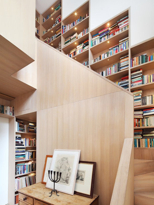 contemporary wooden curved staircase idea in london - Library Design Ideas