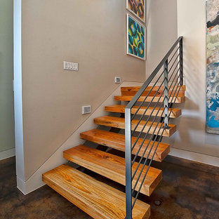 Staircase - contemporary wooden floating open and metal railing staircase idea in Austin
