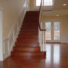 Traditional Staircase by Moser Builders Inc