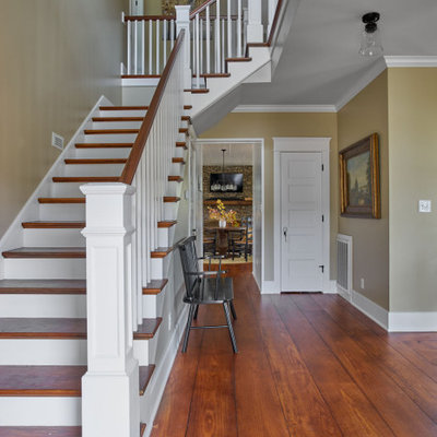 Example of a mid-sized cottage wooden l-shaped wood railing staircase design in Other with painted risers