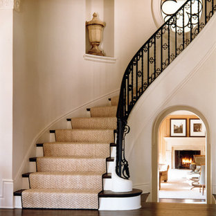 Example of a classic wooden curved staircase design in DC Metro with wooden risers