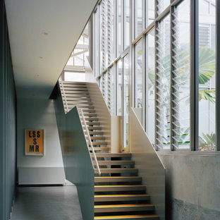 Inspiration for an industrial straight staircase in Sydney with open risers and metal railing.