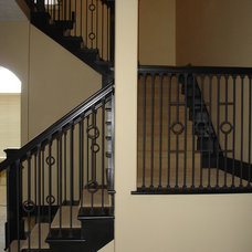 Mediterranean Staircase by Heartwood Custom Homes Inc.