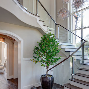 Inspiration for a transitional wooden glass railing staircase remodel in Houston with painted risers
