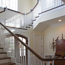 Traditional Staircase by Village Architects AIA, Inc.