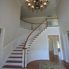 Traditional Staircase by SEKAS HOMES LTD