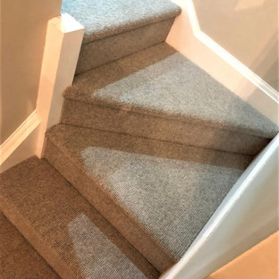 Photo of a medium sized modern l-shaped staircase in Hertfordshire with wood risers.