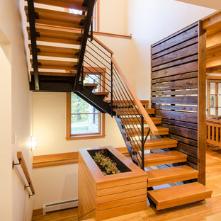 Large country wooden u-shaped open staircase photo in Burlington
