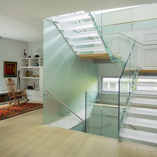 Foto de escalera en U, contemporánea, de tamaño medio, sin contrahuella, con escalones de acrílico