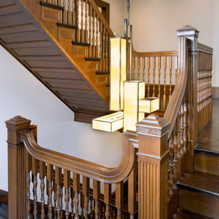 Design ideas for a large victorian wood u-shaped wood railing staircase in Boston with wood risers.