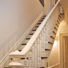 traditional staircase by Chango & Co.