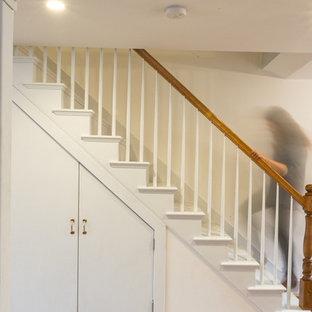 Example of a mid-sized mountain style painted straight staircase design in New York with painted risers