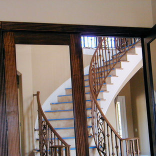 Inspiration for a large painted curved staircase remodel in Tampa with tile risers