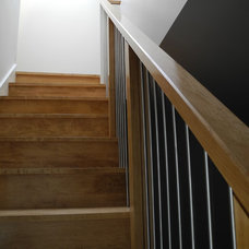 Contemporary Staircase by Delo Interiors Inc.