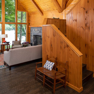 Example of a mountain style wooden u-shaped wood railing staircase design in Minneapolis with wooden risers