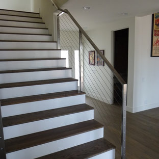 Inspiration for a contemporary wooden straight staircase remodel in Los Angeles with painted risers