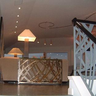 Источник вдохновения для домашнего уюта: лестница среднего размера в стиле модернизм с ступенями из плитки, подступенками из плитки и металлическими перилами
