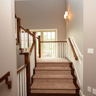 Inspiration for a mid-sized timeless carpeted u-shaped wood railing staircase remodel in Edmonton with carpeted risers