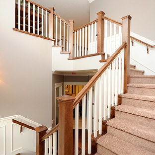 Mid-sized elegant wooden u-shaped wood railing staircase photo in Edmonton with wooden risers