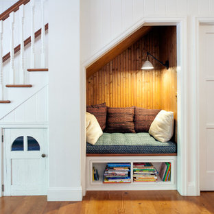 Mid-sized farmhouse wooden straight staircase photo in Los Angeles with painted risers