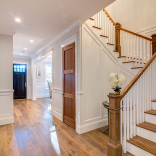 Staircase - mid-sized traditional wooden u-shaped staircase idea in Los Angeles with painted risers