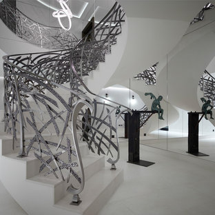 Inspiration for a bohemian spiral metal railing staircase in London.
