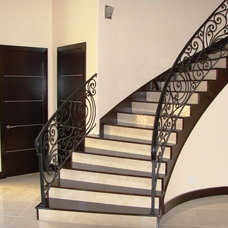 Mediterranean Staircase by Jeffrey Harrington Homes