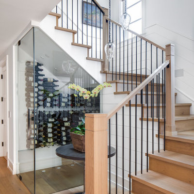 Inspiration for a mid-sized contemporary wooden u-shaped mixed material railing staircase remodel in Los Angeles with wooden risers