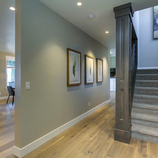 Mid-sized arts and crafts carpeted u-shaped wood railing staircase photo with carpeted risers